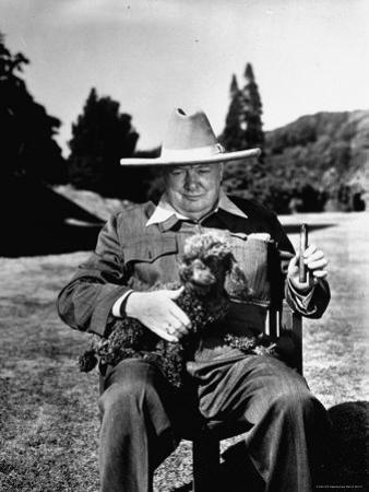 Sir Winston Churchill Wearing Straw Hat While Holding Pet Poodle at Chartwell Manor