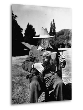Sir Winston Churchill Wearing Straw Hat While Holding Pet Poodle at Chartwell Manor by Hans Wild