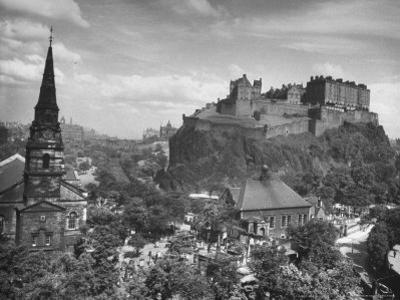 The Edinburgh Castle Sitting High on a Rock Above St. Cuthbert's Church by Hans Wild
