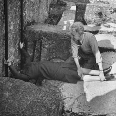 Woman Kissing the Blarney Stone by Hans Wild