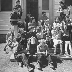 Children and Teacher Sitting Outside One-Room Country School by Hansel Mieth