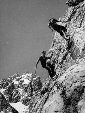 People Climbing the Teton Mountains