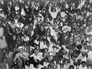 Harlem Crowd Celebrating Joe Louis' Against Victory Against Primo Carnera, 1935