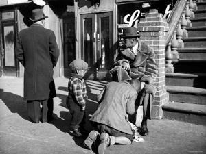 Harlem Street Scene Showing a Man Getting a Shoeshine as a Young Child Watches Intently