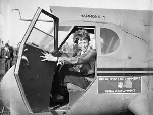 Amelia Earhart in an aeroplane, 1936 by Harris & Ewing