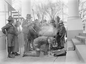 Boy Scouts making a fire for the visit of Sir Robert Baden-Powell to the White House, 1911 by Harris & Ewing