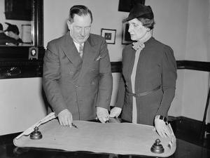 Edwin H. Dressel and Nellie Tayloe Ross discuss the United States gold reserve, 1937 by Harris & Ewing