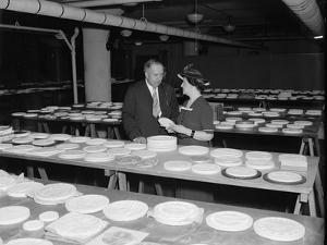 Nellie Tayloe Ross and Edward Bruce inspect designs for new Jefferson nickel, 1938 by Harris & Ewing