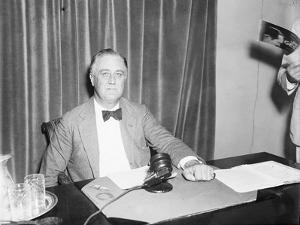 President Roosevelt prepares to broadcast on his recovery programme, 1934 by Harris & Ewing