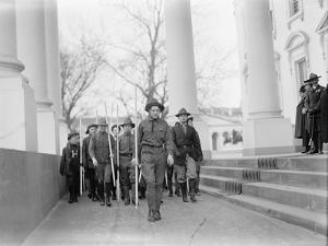 Sir Robert Baden-Powell reviewing a parade of Boy Scouts from the White House portico, 1911 by Harris & Ewing