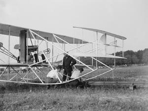 The Wright Brothers put a plane on the launch rail for the first Army flight at Fort Myer by Harris & Ewing