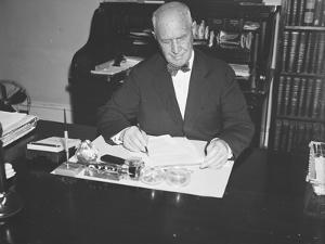 Walter Pierce at his desk, 1934 by Harris & Ewing
