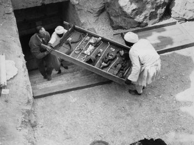 Removing a tray of chariot parts from the Tomb of Tutankhamun, Valley of the Kings, Egypt, 1922 by Harry Burton