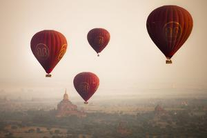 Aerial View of Balloons over Ancient Temples of Bagan at Sunrise in Myanmar by Harry Marx