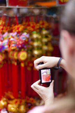 European Tourist Taking a Picture in Chinatown, Singapore by Harry Marx