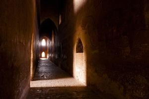 Passage in Buddhist Temple with Incidental Ray of Light in Bagan, Myanmar by Harry Marx