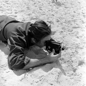 Walt Disney Using Camera in Rio De Janeiro, Brazil, 1941 by Hart Preston