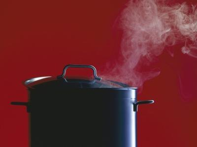 Steam Escaping from a Pan with a Lid