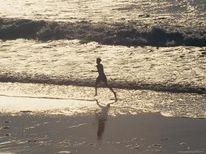 Boy Running on Beach, Venice Beach, CA by Harvey Schwartz