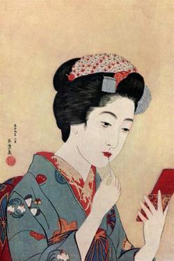 A Japanese woman using a beni brush to paint her lips, 1920 (1930).Artist: Hashiguchi Goyo by Hashiguchi Goyo