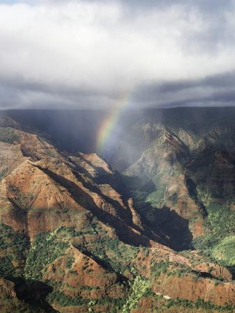 https://imgc.allpostersimages.com/img/posters/hawaii-kauai-waimea-canyon-state-park-a-rainbow-over-waimea-canyon_u-L-PU3NVZ0.jpg?p=0