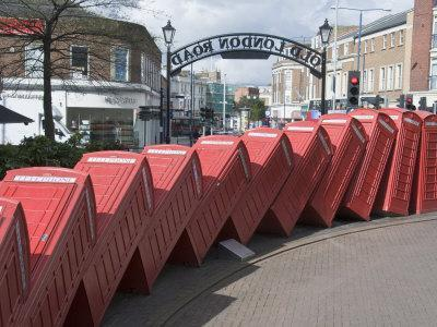 Red Telephone Box Sculpture Out of Order by David Mach. Kingston Upon Thames, Surrey