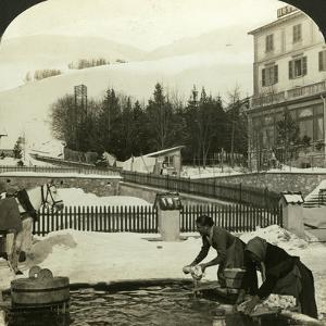 Women Washing Clothes at the Public Fountain in Midwinter, Zuoz, Switzerland by HC White