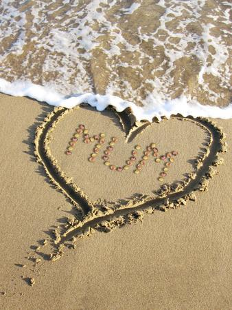https://imgc.allpostersimages.com/img/posters/heart-drawn-in-the-sand-of-a-beach-with-mum-inside_u-L-Q1067ZD0.jpg?artPerspective=n