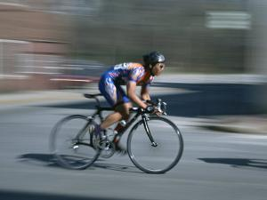 A Bicyclist Speeds Past in a Race by Heather Perry