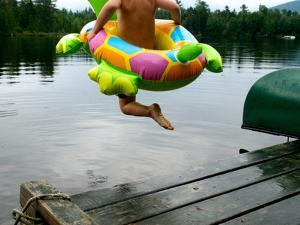 A Boy Jumps from a Dock into the Water by Heather Perry