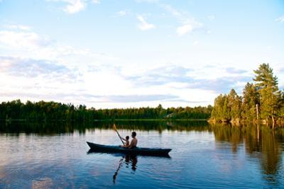 A Man and His Son Kayaking on a Serene Lake by Heather Perry