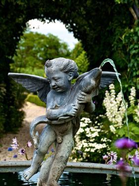 A Sculpted Fountain of a Boy with a Fish in a Castle Garden by Heather Perry