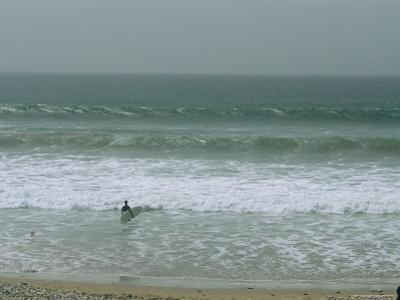 A Surfer Faces the Atlantic Waves in a Moroccan Surf Town by Heather Perry
