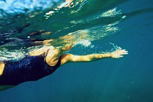 A Woman Swims in the Caribbean Sea by Heather Perry