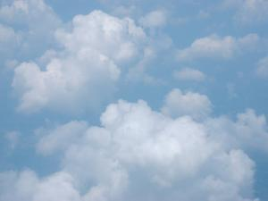 Puffy Cumulus Clouds in the Sky by Heather Perry