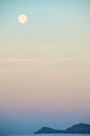 The Full Moon at Moonset over the British Virgin Islands by Heather Perry