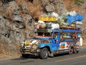 Heavily Loaded Jeepney, a Typical Local Bus, on Kennon Road, Rosario-Baguio, Luzon, Philippines