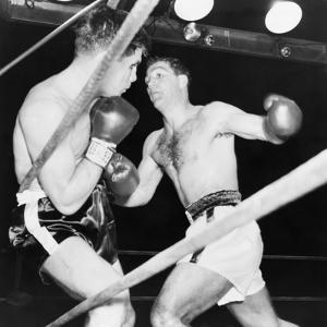 Heavyweight Champion Rocky Marciano (Right) Backs Roland Lastarza Against the Ropes