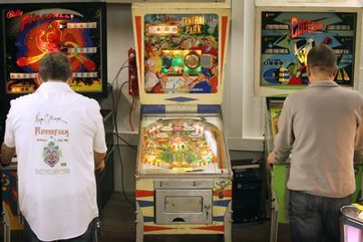 Visitors Play at Historic Pinball Machines at Pinball Museum in Ruprechtshofen