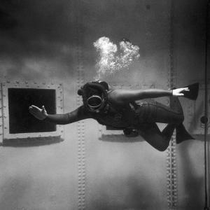 A Scuba Diver Inside a Large Metal Water Tank. Photograph by Heinz Zinram by Heinz Zinram
