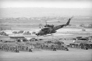 Helicopter Flying over Land Site