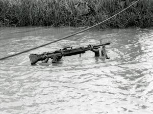 Vietnam War Submerged Gunner by Henri Huet