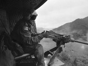 Vietnam War US Helicopter Gunner by Henri Huet