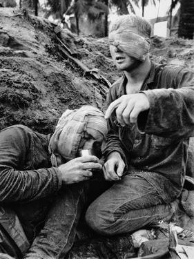 Vietnam War Wounded Medic by Henri Huet