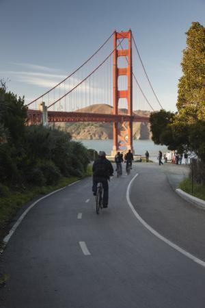 Bicycle Riders Golden Gate Bridge by Henri Silberman
