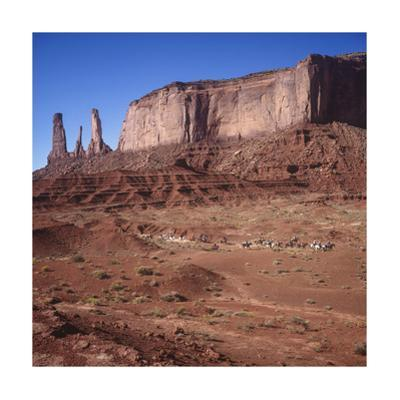 Monument Valley, Arizona Horseback Riders - Iconic Western Landscape by Henri Silberman