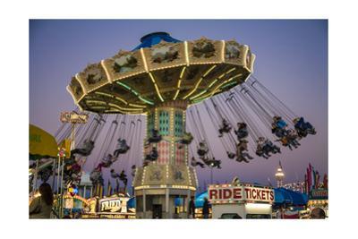 State Fair Ride at Dusk by Henri Silberman