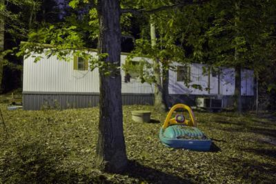 Trailer in Woods with Toys (Night) by Henri Silberman