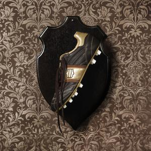 Football Boot Hanging as a Trophy on a Wall by Henrik Sorensen