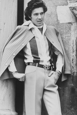 Male Model Wearing Silk Shirt and Wool Crepe Trousers by Henry Clarke